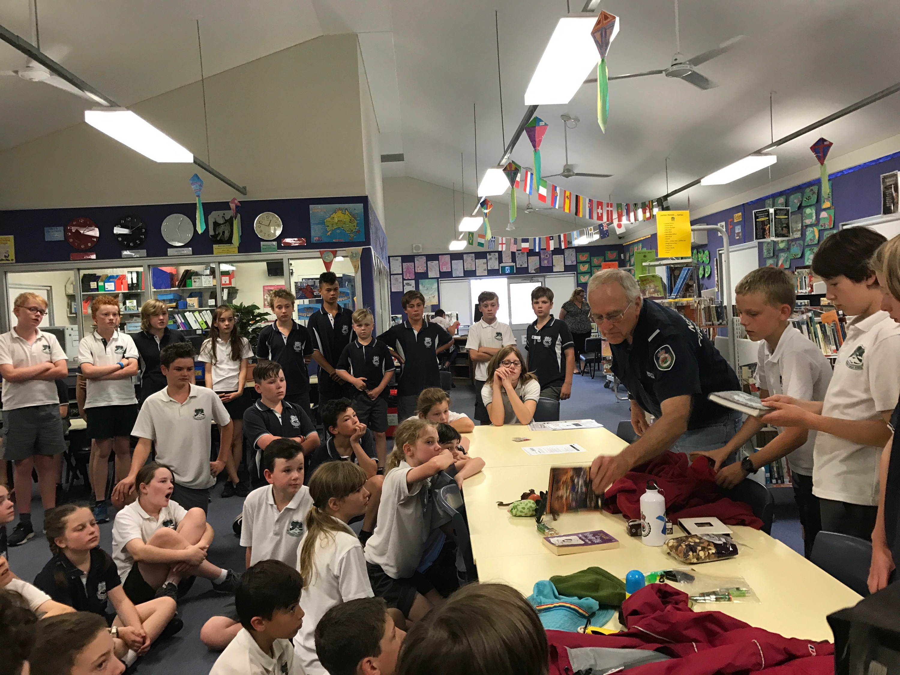 Warrimoo Public School students and NSW Rural Fire Service checking emergency kit